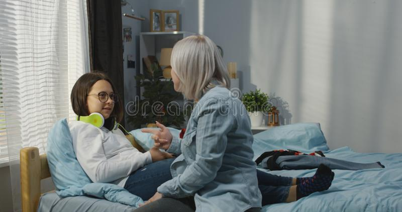 Mother and daughter in bedroom stock photos