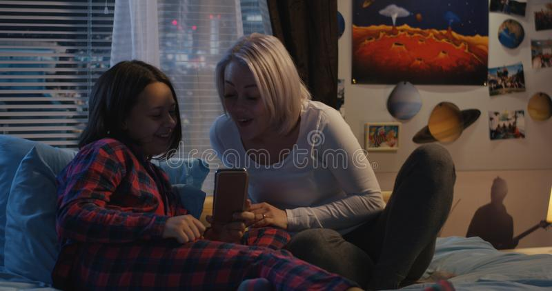 Mother and daughter using smartphone royalty free stock photo