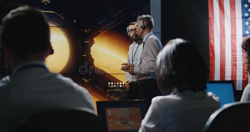 Technician overlooking Mars expedition royalty free stock image