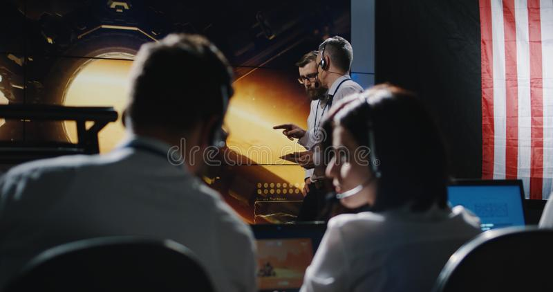 Technician overlooking Mars expedition stock photography