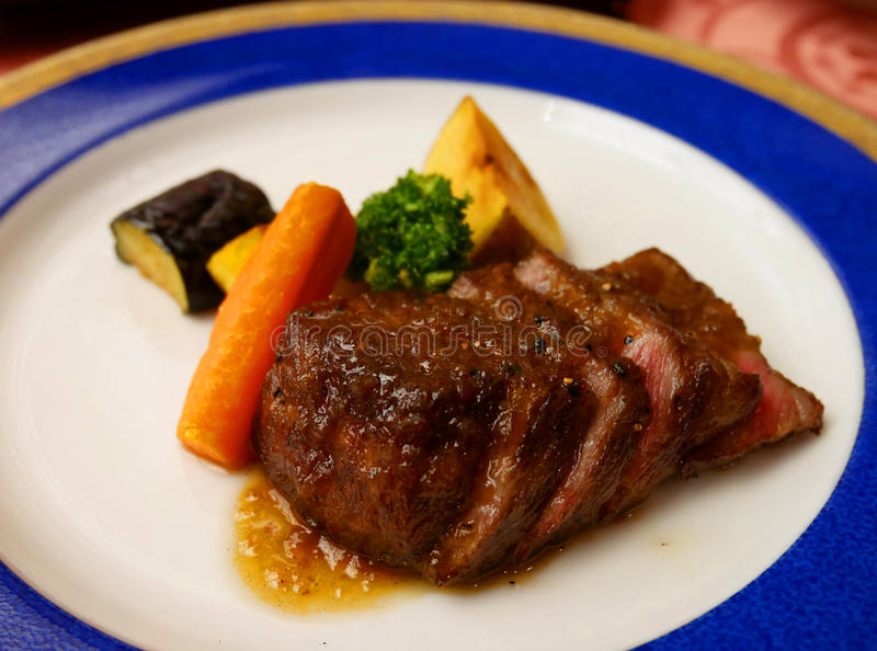 Medium rare juicy beef steak stock image