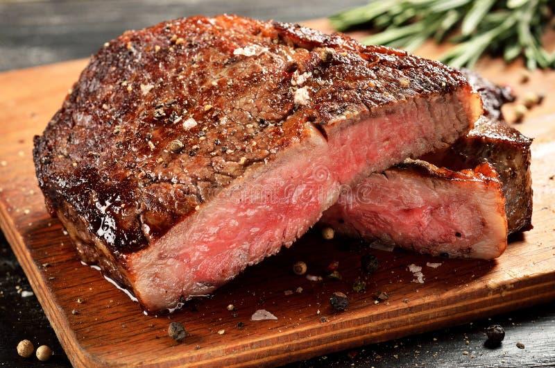 Medium Rare Ribeye steak on wooden board, selected focus. Prime Black Angus Ribeye steak. Medium Rare degree of steak doneness royalty free stock photo