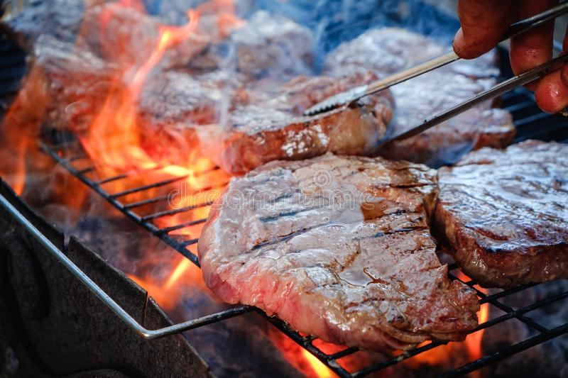 Medium rare sliced grilled striploin beef steak. Barbecue meat on the grill royalty free stock photography