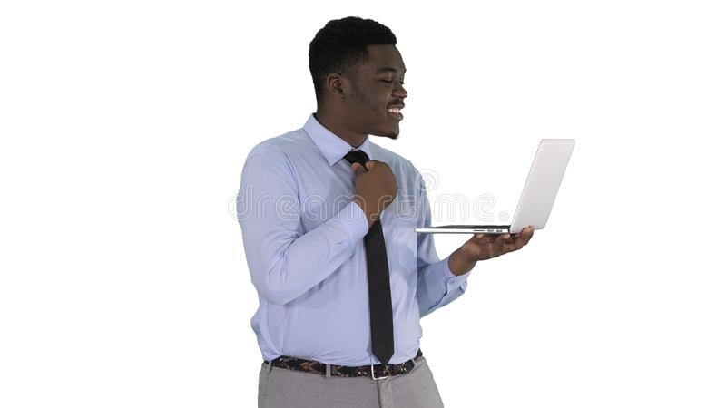 Cheerful successful young African American manager with laptop having video conference call with business partners on. Medium shot. Cheerful successful young stock photos