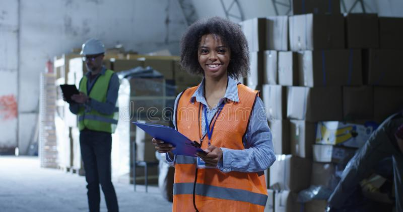 Supervisor in a warehouse. Medium shot of female supervisor in a warehouse stock photos