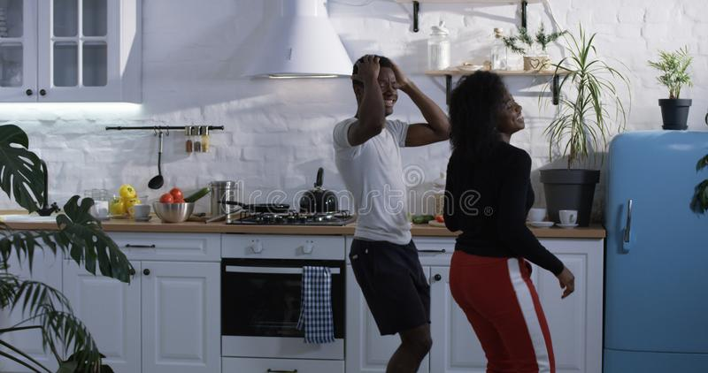 Couple dancing in the kitchen stock image