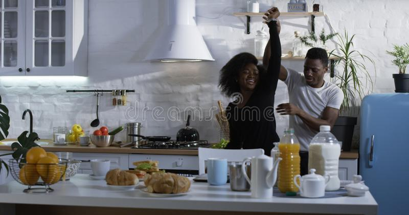 Couple dancing in the kitchen stock photography
