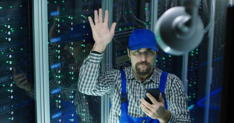 Technician checking camera at a data center stock photos