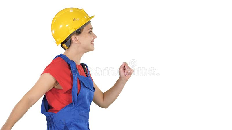 Female worker in hardhat walking happy Construction and architecture concept on white background. royalty free stock images