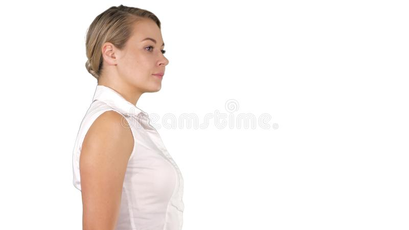 Young business woman walking on white background. stock image