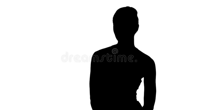 Silhouette Beautiful girl in sportswear listening to someone talking to her. royalty free stock image