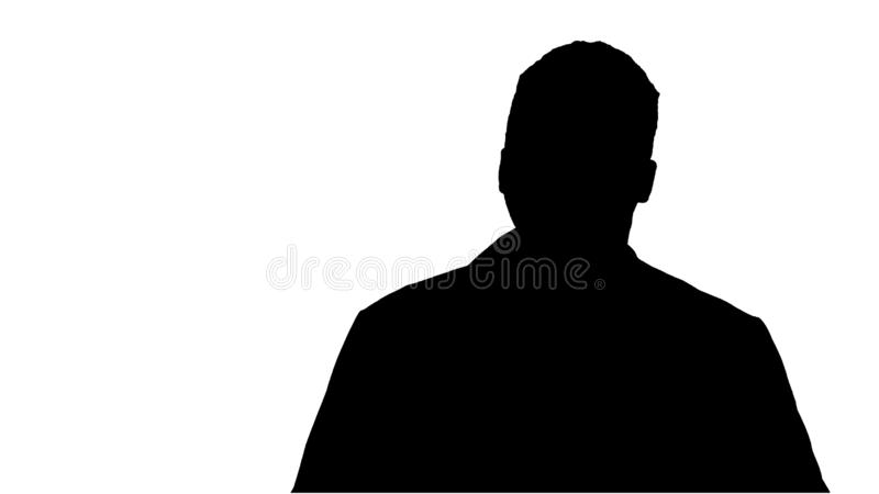 Silhouette Male African Doctor Standing With Hands In His Pockets. royalty free stock photos