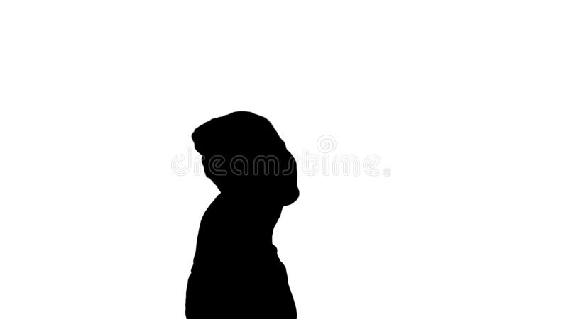 Silhouette Young girl is making a pause while doing yoga. She looks very peaceful and calm, also she feels happiness and stock photo