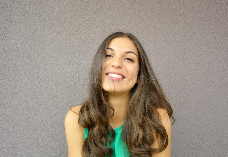 Medium shot of smiling pretty young woman against violet background stock photo