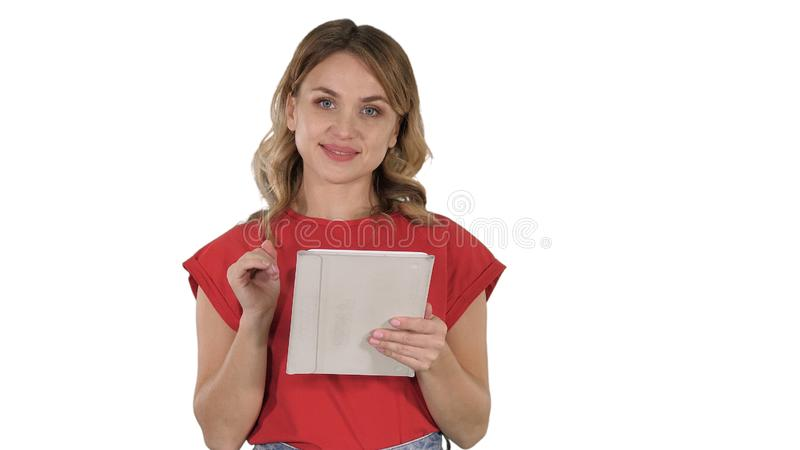 Smiling woman with tablet computer presenting turning pages on white background. royalty free stock image