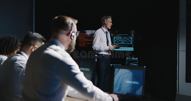 Technicians overlooking Mars mission stock images