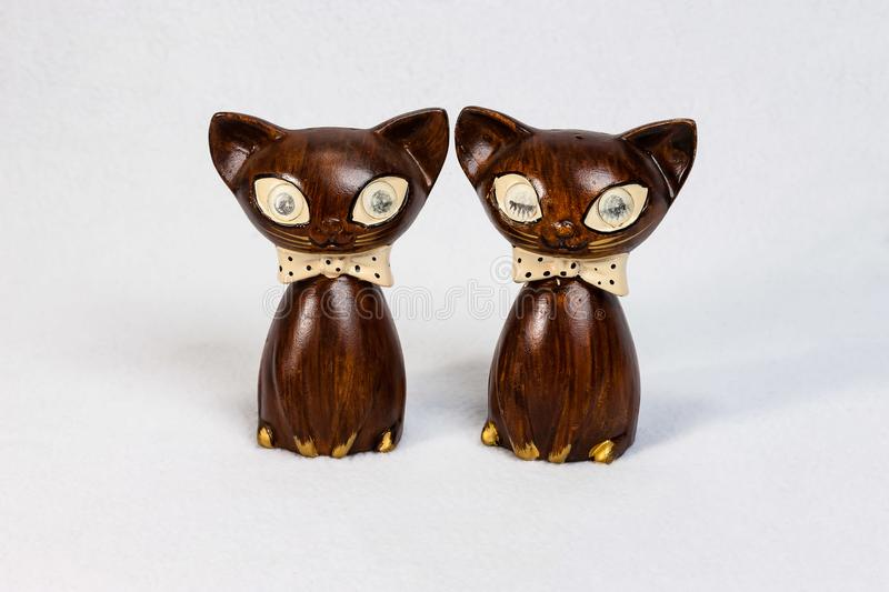 Medium sized wooden cat salt and pepper shakers. Medium sized wooden cat salt and pepper shaker set royalty free stock image