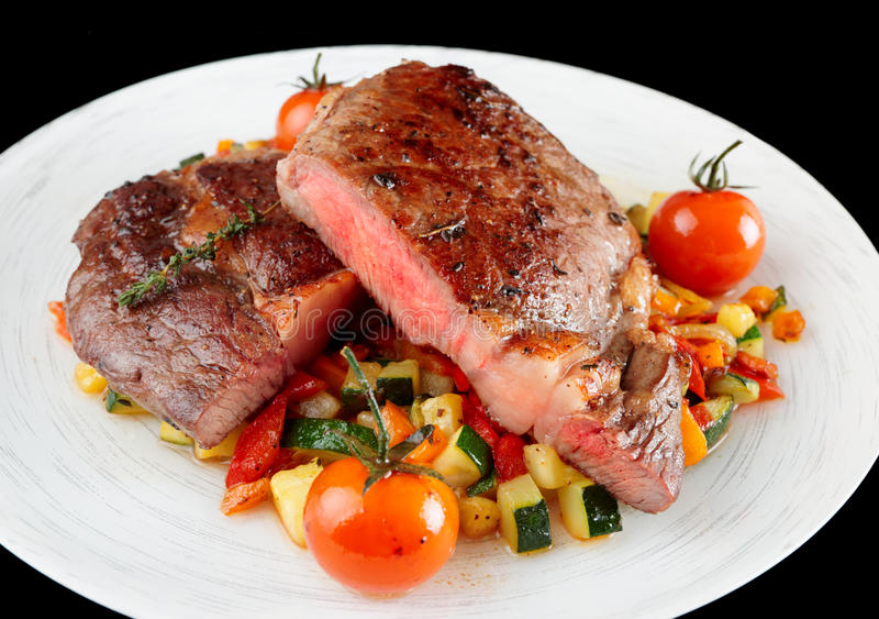 Medium Well Fried Steak With Vegetables Stock Image