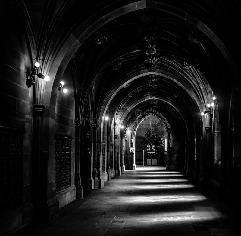 Medival looking corridor stunning light from arched windows. Black and white, fine art, natural light stock photography