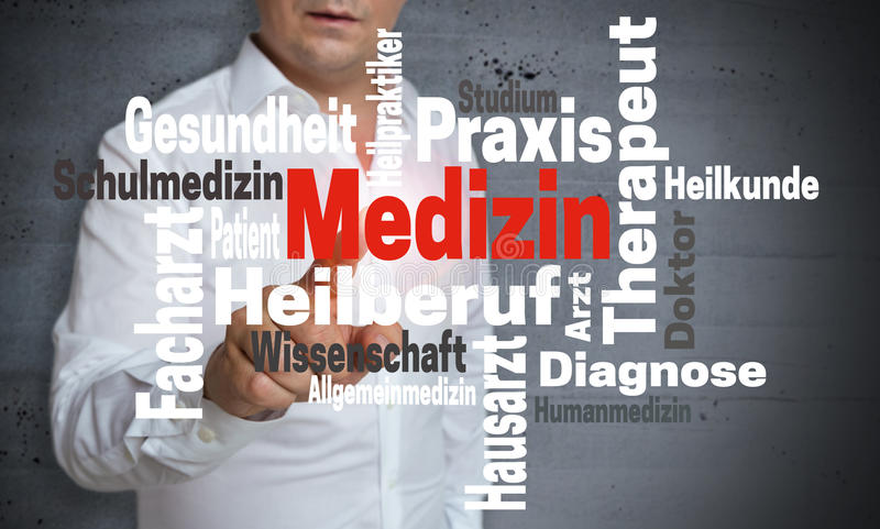 Medizin in german Medicine wordcloud touchscreen is operated b. Y man stock image