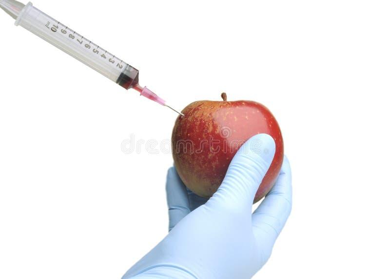 Medizinische Spritze in der Frucht lizenzfreies stockbild