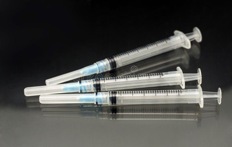 Medizinische Spritze der Schutzimpfungs-drei stockfotografie