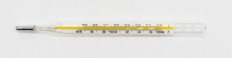 Medizinischer Thermometer getrennt auf Weiß lizenzfreies stockbild