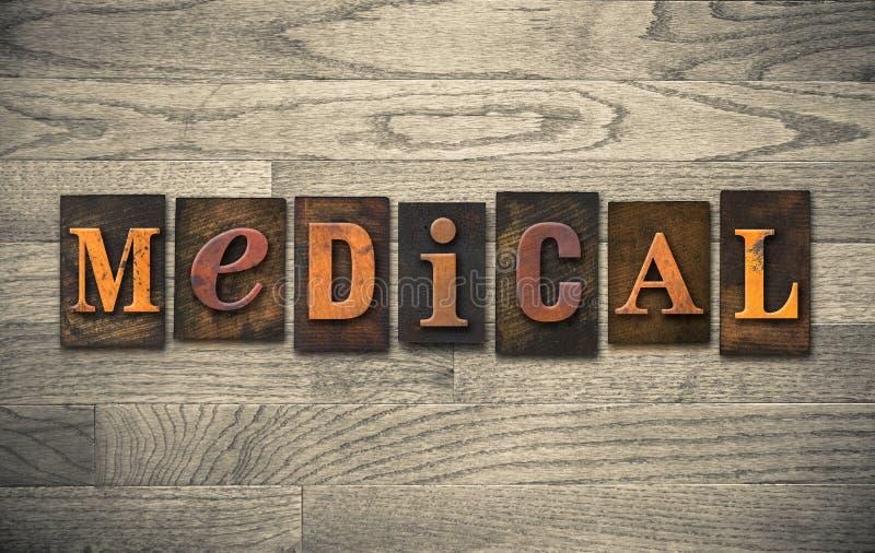 Medizinisches hölzernes Briefbeschwerer-Thema stockbild