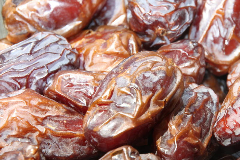 Medjool dates. Have been called the king of dates - fresh dates, delicious fruits of date palm trees royalty free stock photography