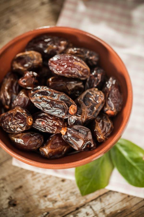 Medjool dates. Extra sweet medjool dates in rustical bowl stock photography