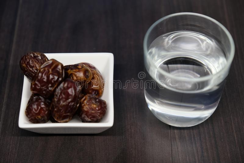 Medjool Dates on table. Medjool Dates on wooden table royalty free stock image