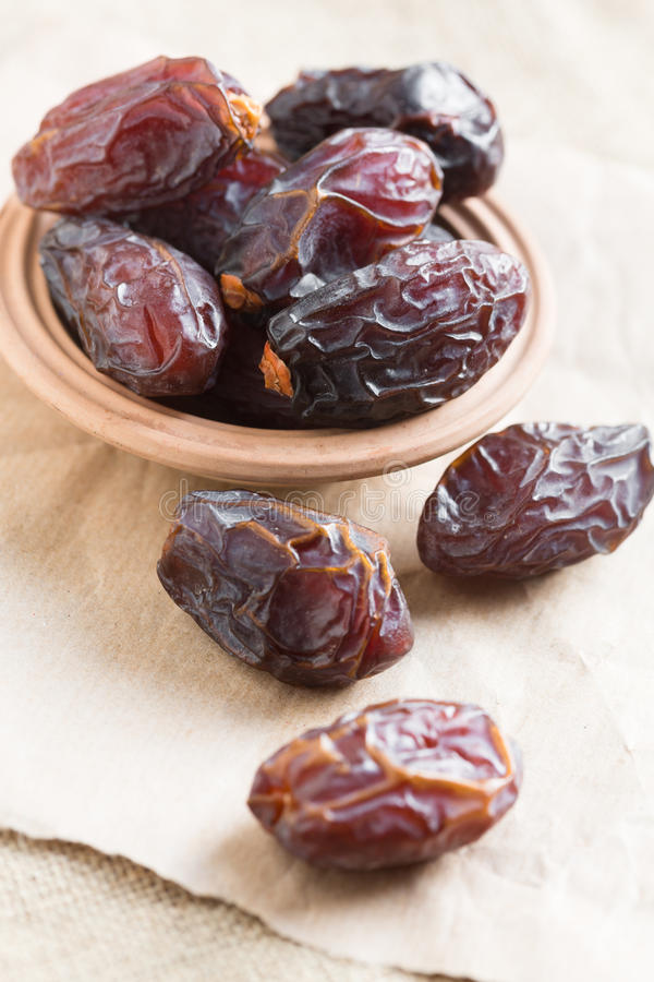 Medjoul or Medjool dates. In a bowl closeup stock photography