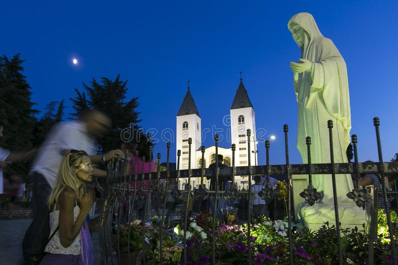 Medjugorie - The place where appear the Virgin Mary. Pillgrims goes to the mass stock photos