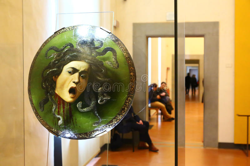 Medusa som målar vid Caravaggio i det Uffizi museet, Florence royaltyfria foton