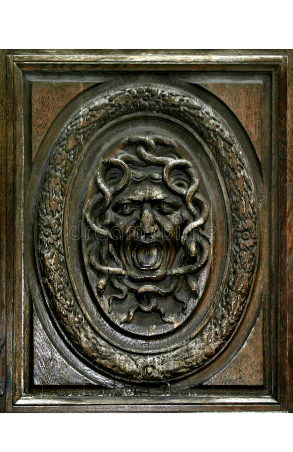 Medusa on Wooden Door In Paris stock images