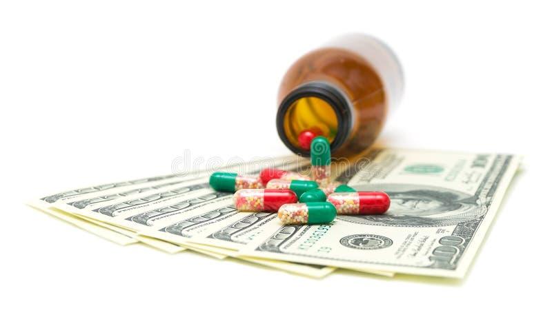 Medyczni leki w USA dolary na biel zdjęcia royalty free