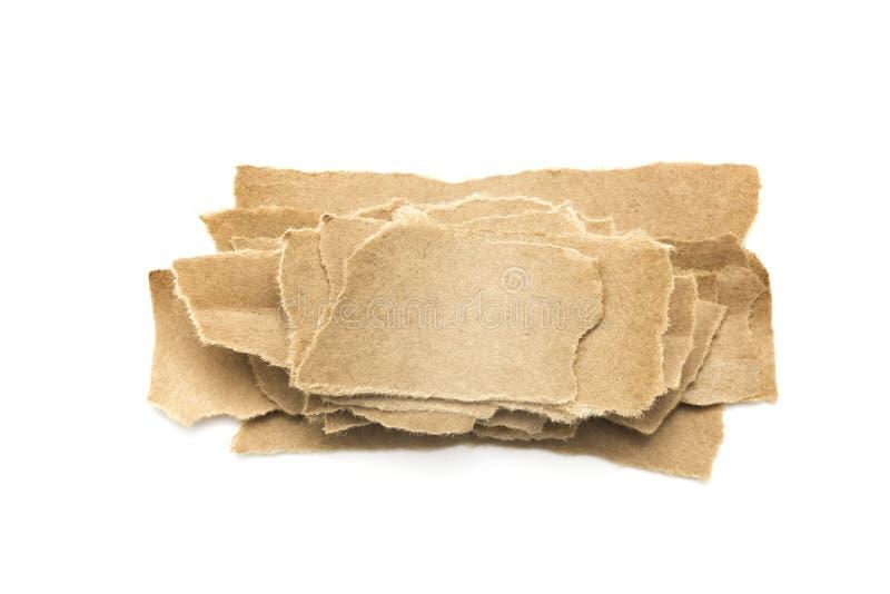 Meerdere lagen van gescheurd verpakkingspapier stock foto's