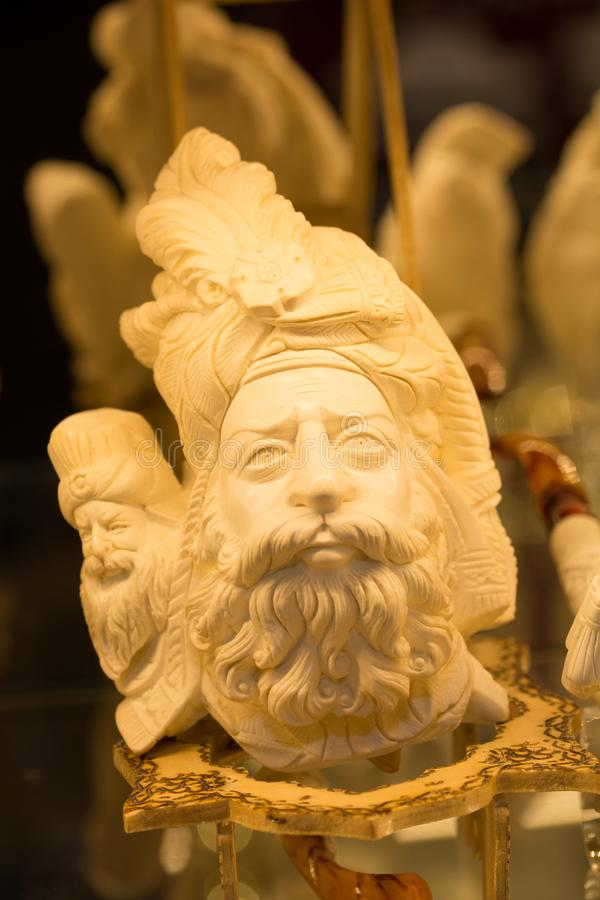 Meerschaum tobacco pipe. In the form of sculptures. Almost all of meerschaum is removed from Eskisehir / Turkey. master craftsmanship stock images
