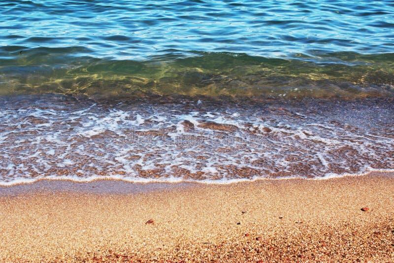 Meerwasser und Sandhintergrund stockfoto