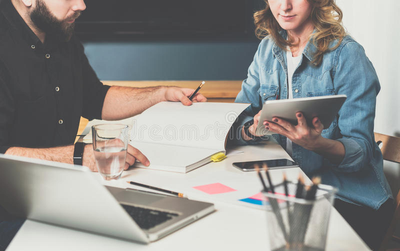 Meet one-on-one. Business meeting. Teamwork. Businessman and businesswoman sitting at table. royalty free stock photo