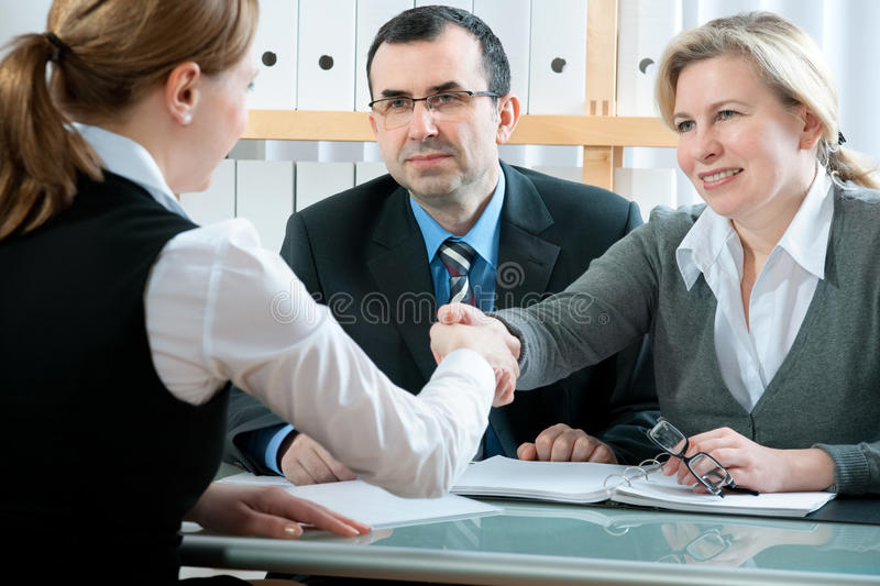 Meeting. Mid-adult couple meeting with financial planner royalty free stock images