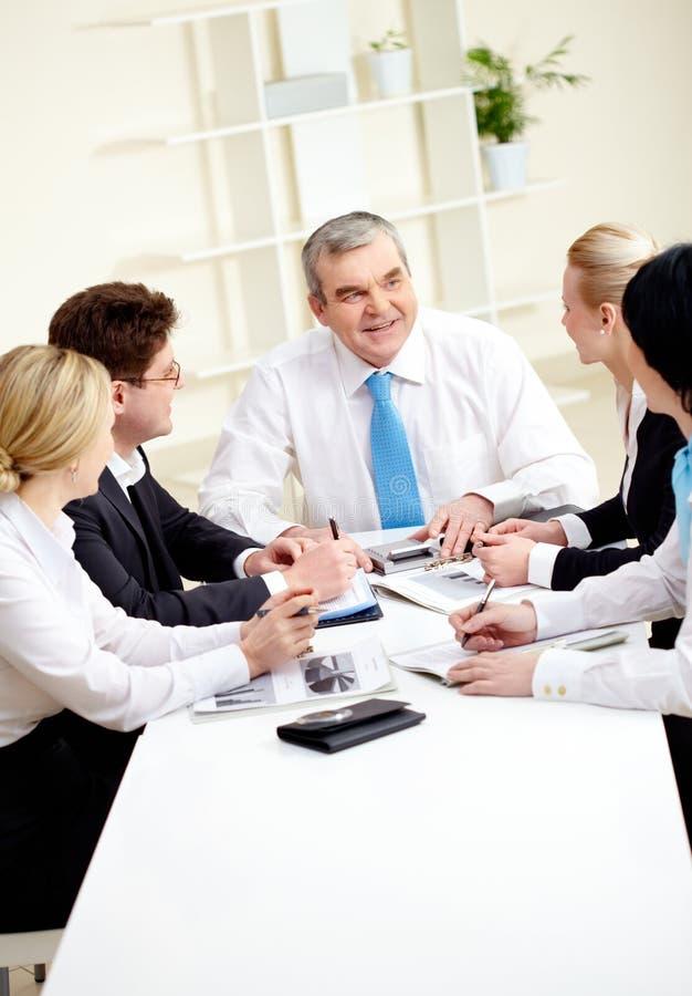 At meeting. Image of senior leader making speech at meeting stock photo