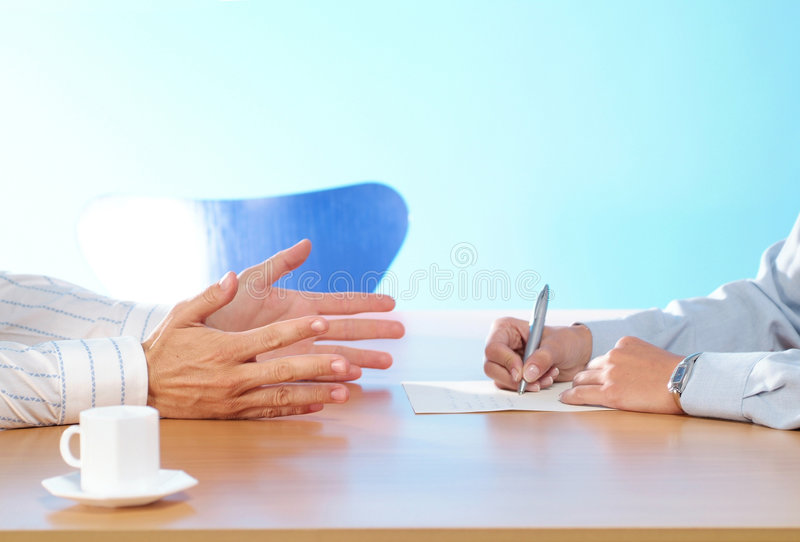 Meeting. Man dictate and woman write hand