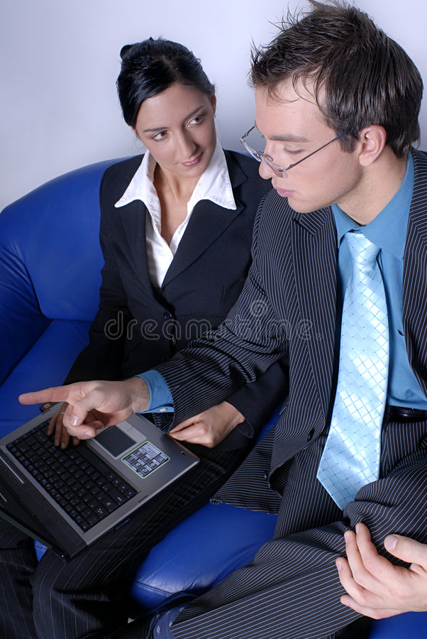 Meeting. A business man and woman having a meeting royalty free stock image
