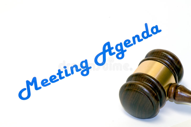 Meeting agenda and gavel stock photo