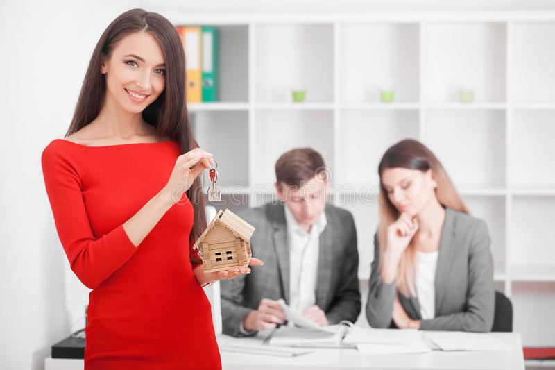 Meeting with agent in office, buying renting apartment or house, buyers of real estate ready to conclude a deal, family couple sh. Aking hands with realtor after royalty free stock photos