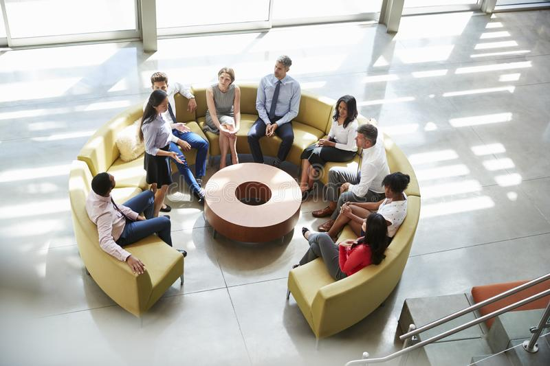 Meeting in a business lounge area, elevated view royalty free stock photos