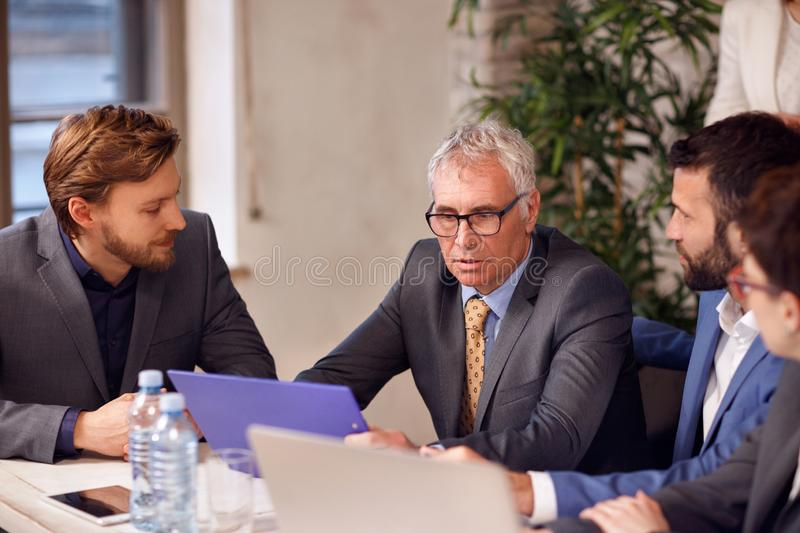 Meeting of business people. Discussion meeting of business people royalty free stock images
