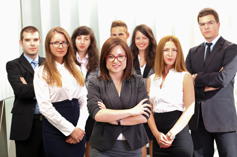 The meeting. A business team standing in office after a successful business stock images