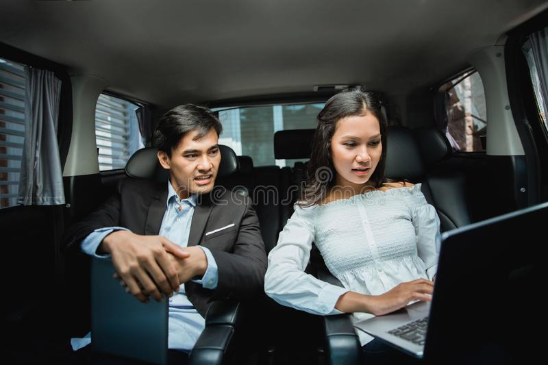 Meeting in the car asian business people royalty free stock photos